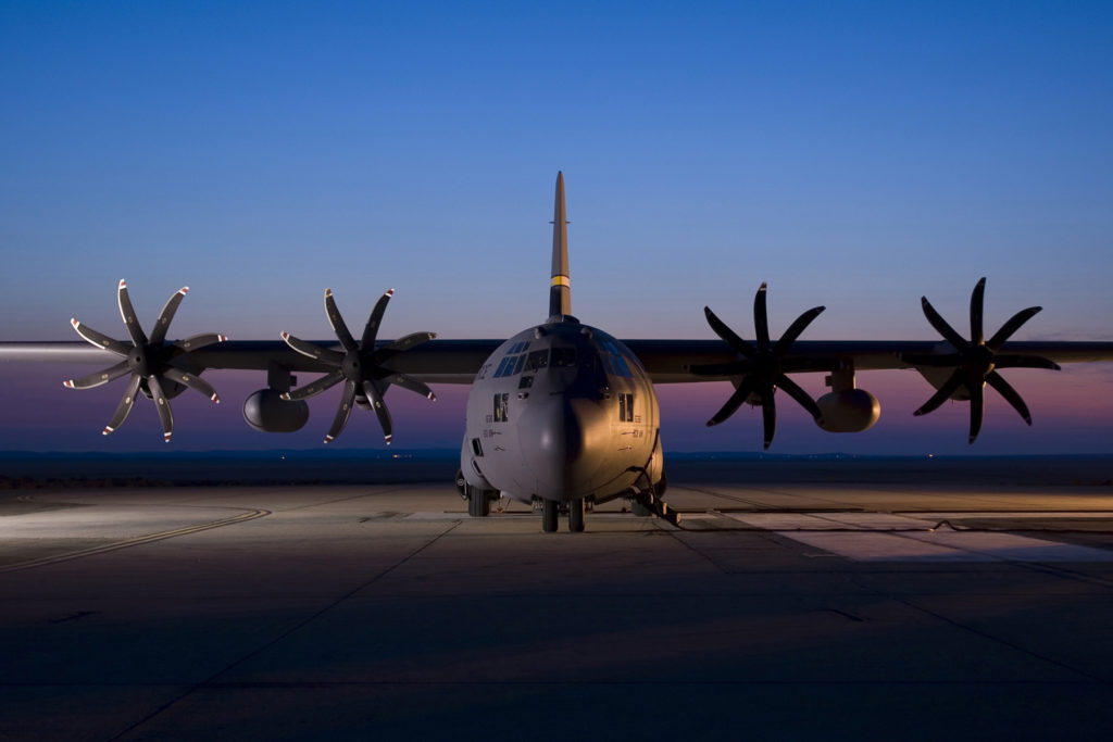 A C-130H Hercules aircraft assigned to the 153rd Airlift Wing, Wyoming Air National Guard is seen parked on the ramp at Edwards AFB in California. The C-130 is modified with an Electronic Propeller Control System and eight-bladed propeller system. (Courtesy photo)